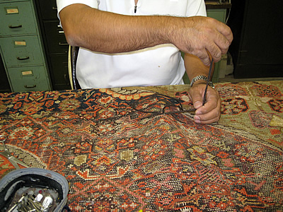 Area rug weaving and restoration
